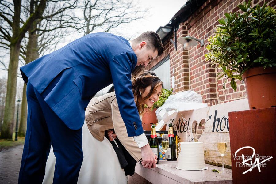 Fotograaf huwelijk kasteelhoeve Geldrop bruidstaart