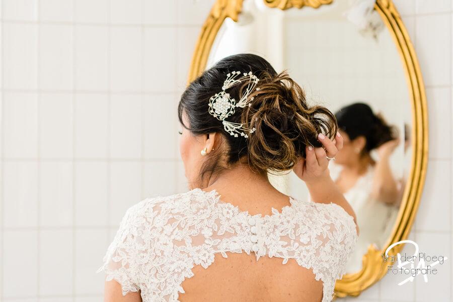 Henkenshage fotograaf trouwfotografie kapsel Brabant